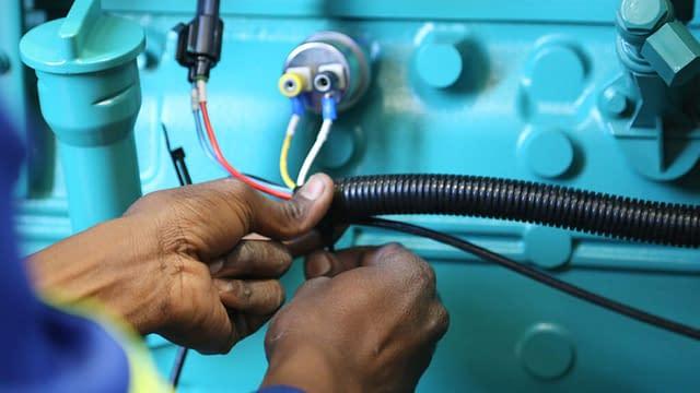 Technician wiring a Generator | Diesel Generator for Sale | Generator King